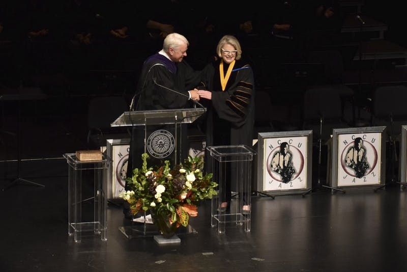 Chair Bissette congratulates President Margaret Spellings at her inauguration on Thursday at Memorial Hall.