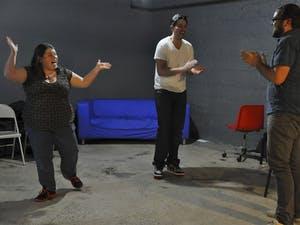 """Three Dollar Bill LGBTQ comedy group rehearsed before their performance Tuesday night at DSI Comedy on West Franklin Street. Meagan Voss of Carrboro, Robbie Wiggins of Raleigh and Brandon Holmes of Durham were playing a warm-up game called """"Czechoslovakia."""""""