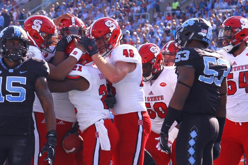 N.C. State players celebrate after a touchdown.