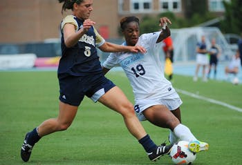 UNC midfielder Crystal Dunn (19) fights Notre Dame defender Cari Roccaro (5) for possession of the ball.