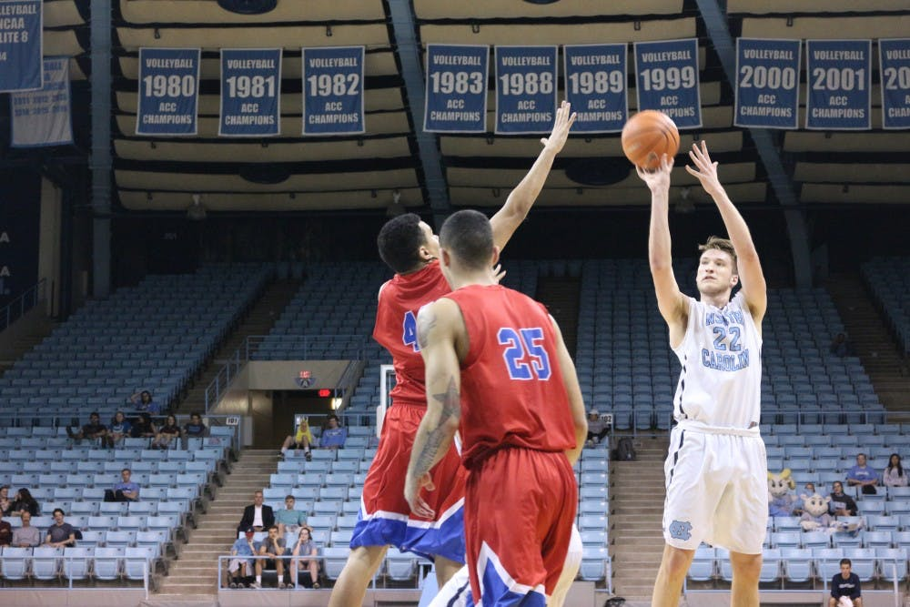 On Dean Smith Tribute Night, UNC JV basketball wins 75-61 in Carmichael Arena