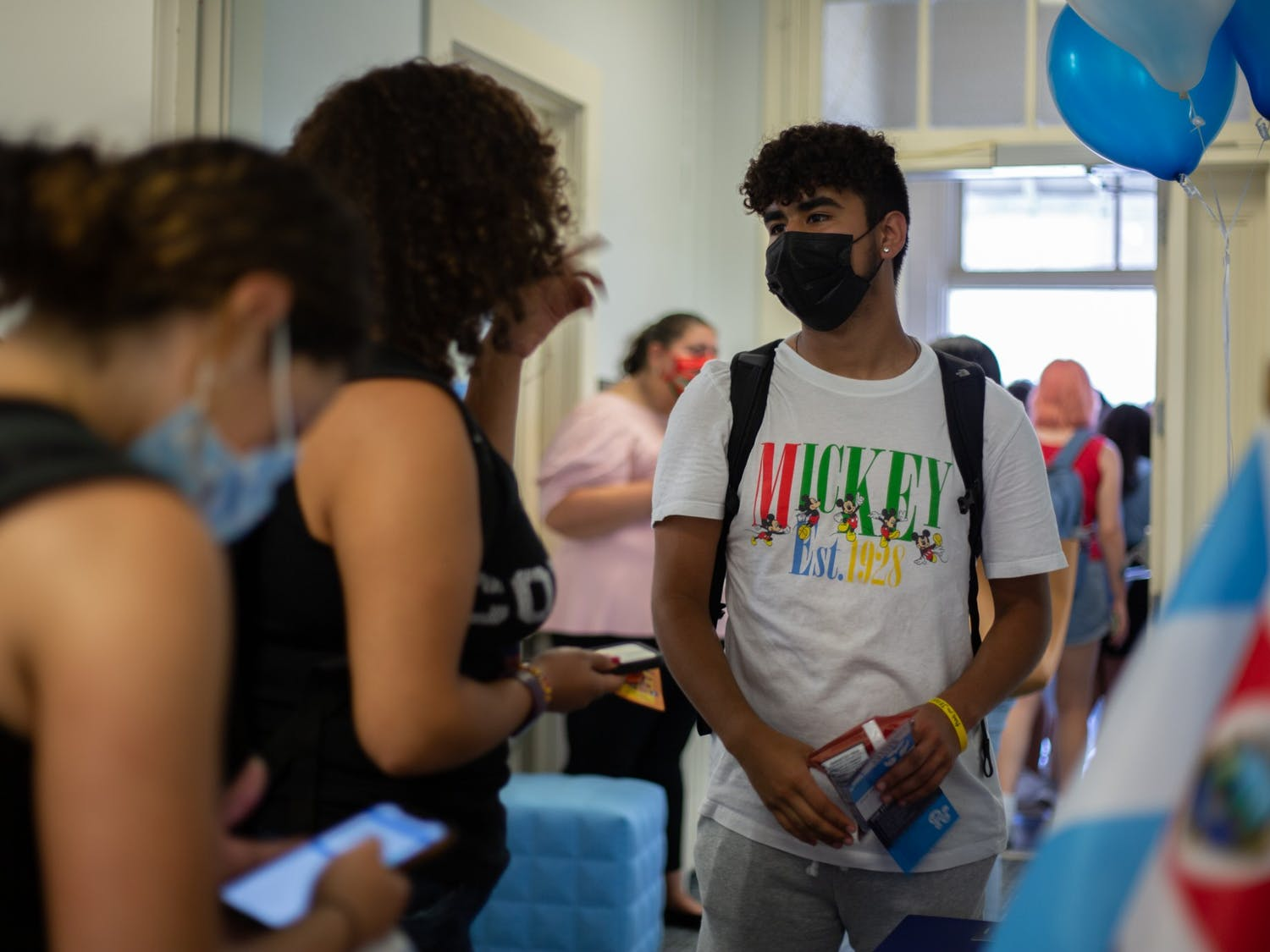 Eddy Velazquez, a sophomore pre-business major, talks to another student at the Carolina Latinx Center's open house event on Aug. 25.