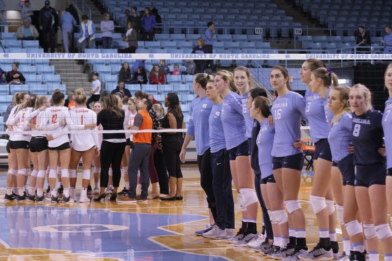 The UNC volleyball team sings the alma mater after its 3-0 win against Clemson on Saturday afternoon in Carmichael Arena.