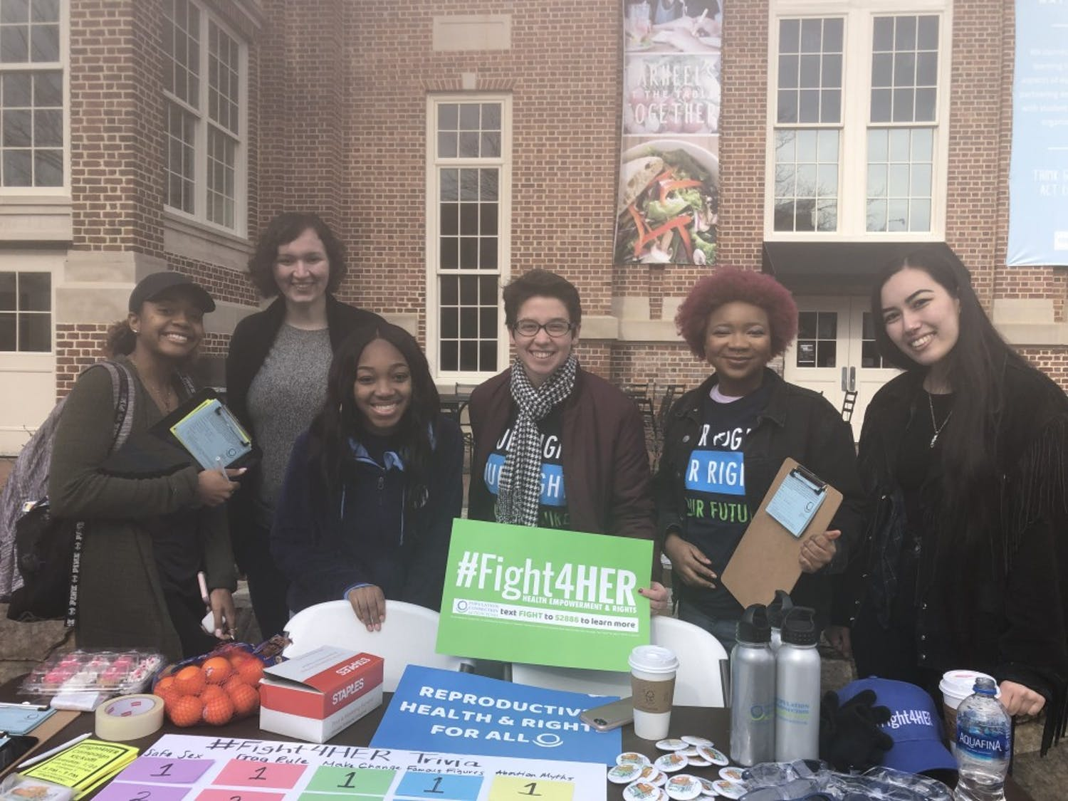 Members of the #Fight4HER campaign at an event in the Pit on Jan. 17, 2019. #Fight4HER is a grassroots campaign founded by the Population Connection, the largest grassroots population organization in the United States, according to its website. #Fight4HER's mission is to block Trump's Protecting Life in Global Health Assistance policy, his 2017 extension of Ronald Reagan's global gag rule that restricted NGOs from using any of the country's $8.8 billion of global health funding for organizations that provide abortion services or referrals.