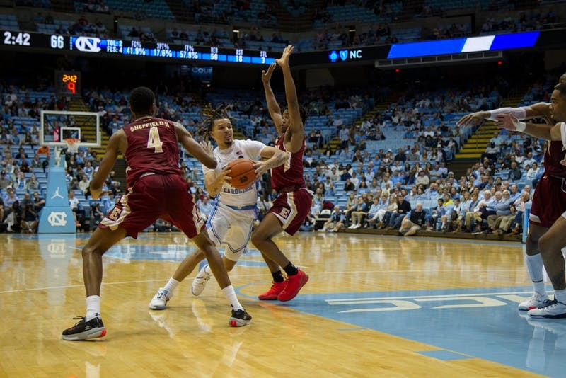 First-year guard Cole Anthony (2) pushes past opposing players in basketball game against Elon University on Thursday, Nov. 20, 2019. UNC won 75-61.