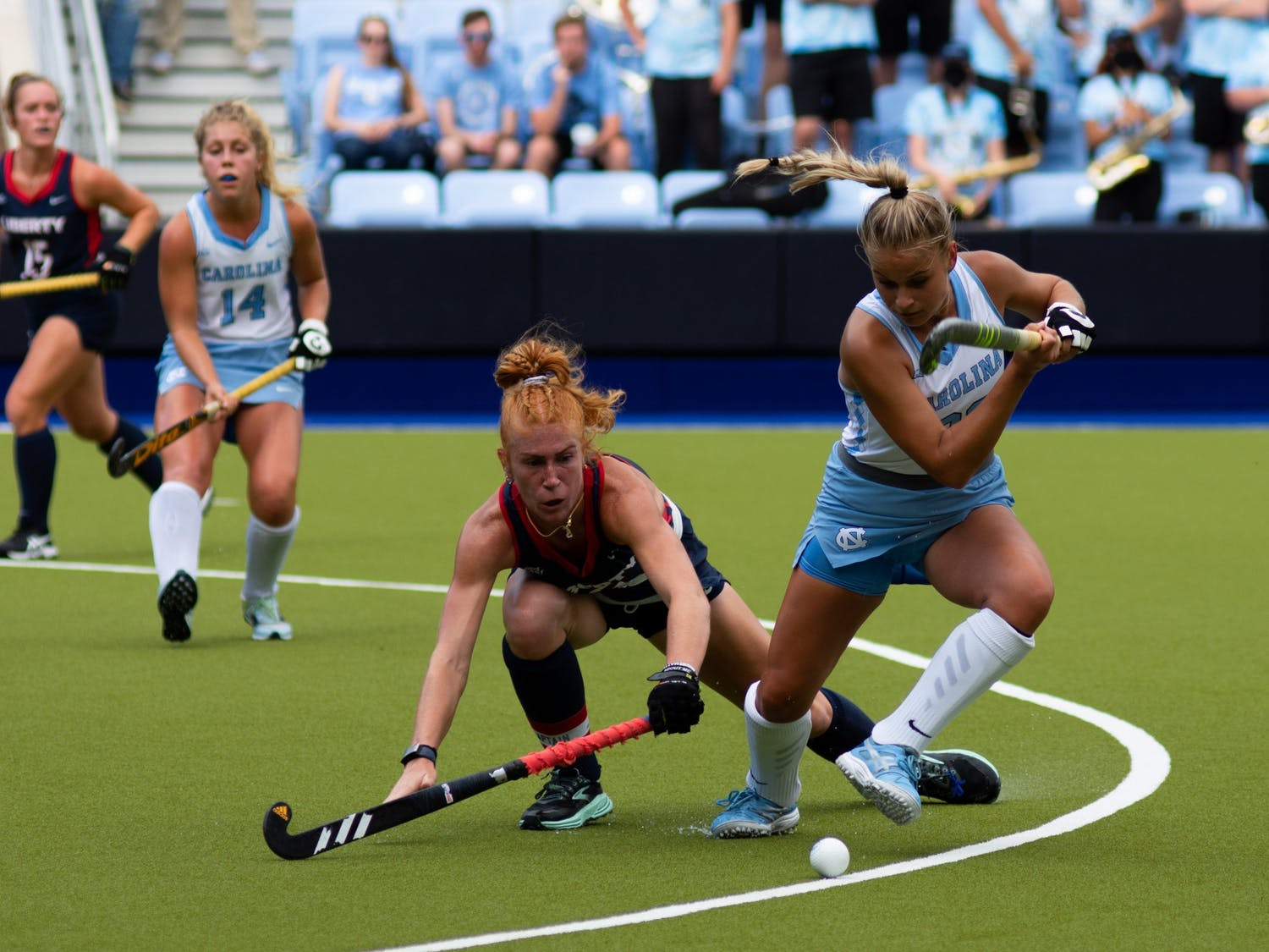 Freshman midfielder Jasmina Smolenaars (22) retains possession of the ball during UNC's Oct. 10 field hockey game against Liberty. The game proved to be a loss for the Tar Heels–Liberty headed home with a 4-0 win.