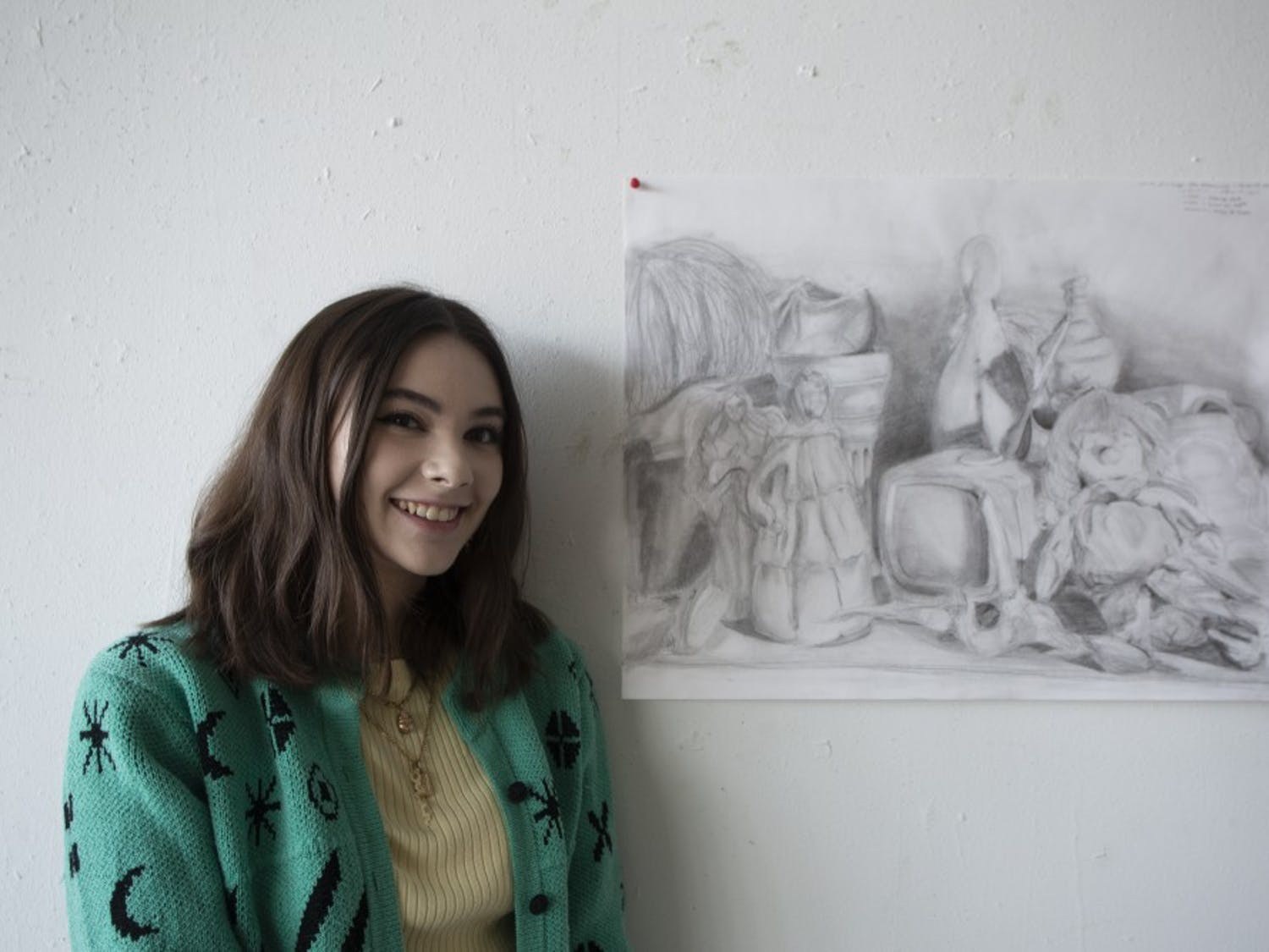 """Sidney Hines, a UNC sophomore shows her drawings she made over the past year.""""I was in the moment, it wasn't a thought out thing like most of the larger projects,"""" she said on Friday Oct. 11, 2019."""