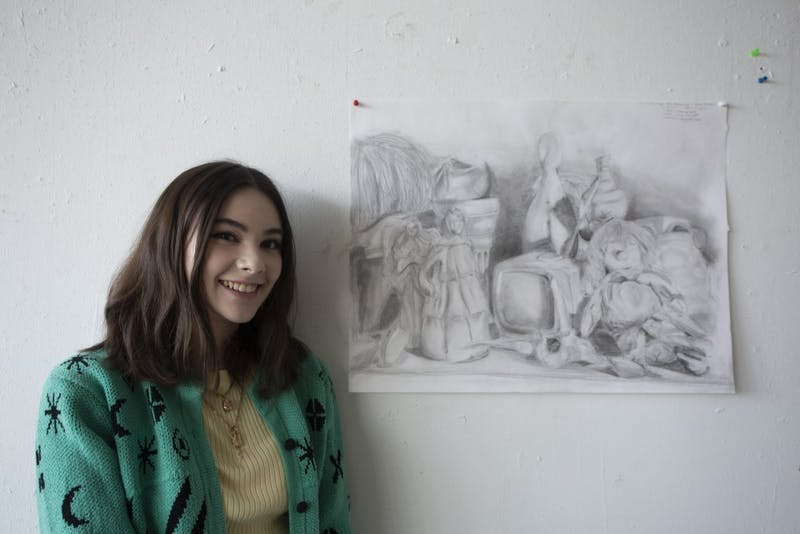 "Sidney Hines, a UNC sophomore shows her drawings she made over the past year.""I was in the moment, it wasn't a thought out thing like most of the larger projects,"" she said on Friday Oct. 11, 2019."