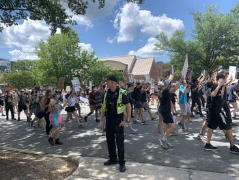 A Chapel Hill Police Officer stands guard at the Chapel Hill protest hosted by Black Congress on Friday, June 15, 2020.
