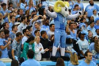 Rameses joins the student section to help pump up the crowd at a football game in 2015.