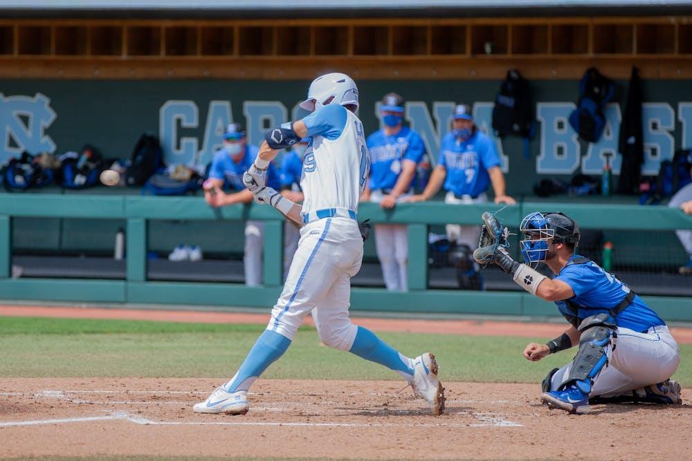 First year infielder Johnny Castagnozzi (19) bats at the game against Duke on Saturday Apr. 10 2021 at Boshamer stadium. UNC lost 2-4.