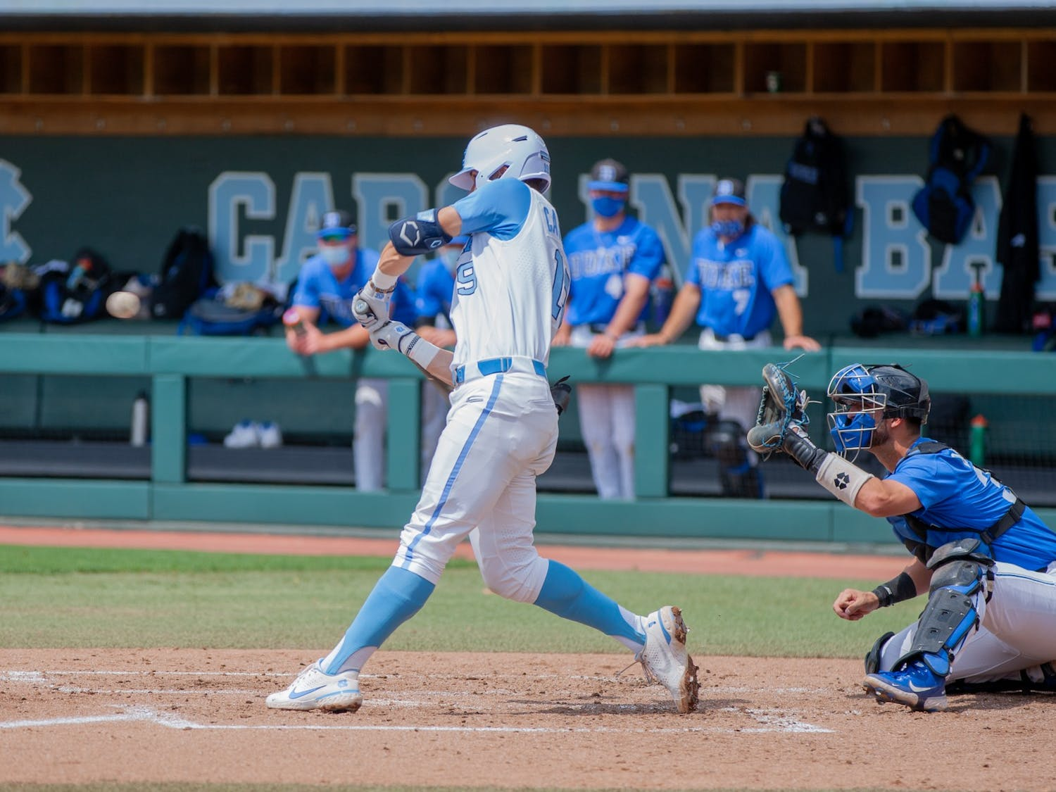 First year infielder Johnny Castagnozzi (19) bats at the game against Duke on Saturday Apr. 10 2021 at Boshamer stadium. UNC lost 2-4.