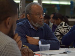 """Burns Ray, a UNC alumnus, participates in one of the workshops on Saturday, Feb. 16, 2019, at the Blue Zone. """"It was great,"""" says Ray about the Black Male Unity Dinner. """"If you want progress, you need to have them more than once a year."""""""