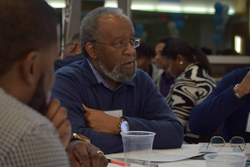 "Burns Ray, a UNC alumnus, participates in one of the workshops on Saturday, Feb. 16, 2019, at the Blue Zone. ""It was great,"" says Ray about the Black Male Unity Dinner. ""If you want progress, you need to have them more than once a year."""