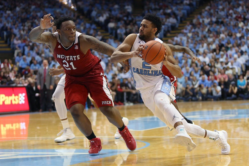 <p>Guard Joel Berry II (2) drives toward the basket during the game against N.C. State in the Smith Center on Saturday, Jan. 16. 2016. UNC beat N.C. State 67-55.&nbsp;</p>
