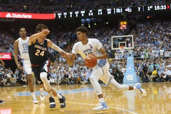 UNC guard Cameron Johnson charges through the Gonzaga defense during a game at the Dean Dome on Saturday night. UNC won 103 - 90.