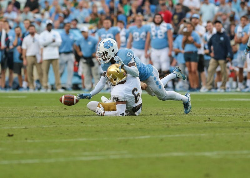 Cornerback K.J. Sails (9) breaks up a pass intended for Notre Dame wide receiver Equanimeous St. Brown (6) on Oct. 7 in Kenan Memorial Stadium.