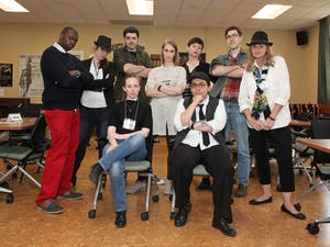 Library workers pose as members of the Supernatural Investigation Agency during last spring's game of Clue. Photo courtesy of Bob Schreiner.