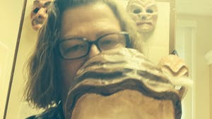 UNC classics Professor Sharon James holds a mask used during their classes. James recently won the Board of Governor's 2021 excellence in teaching award. Photo courtesy of Sharon James.