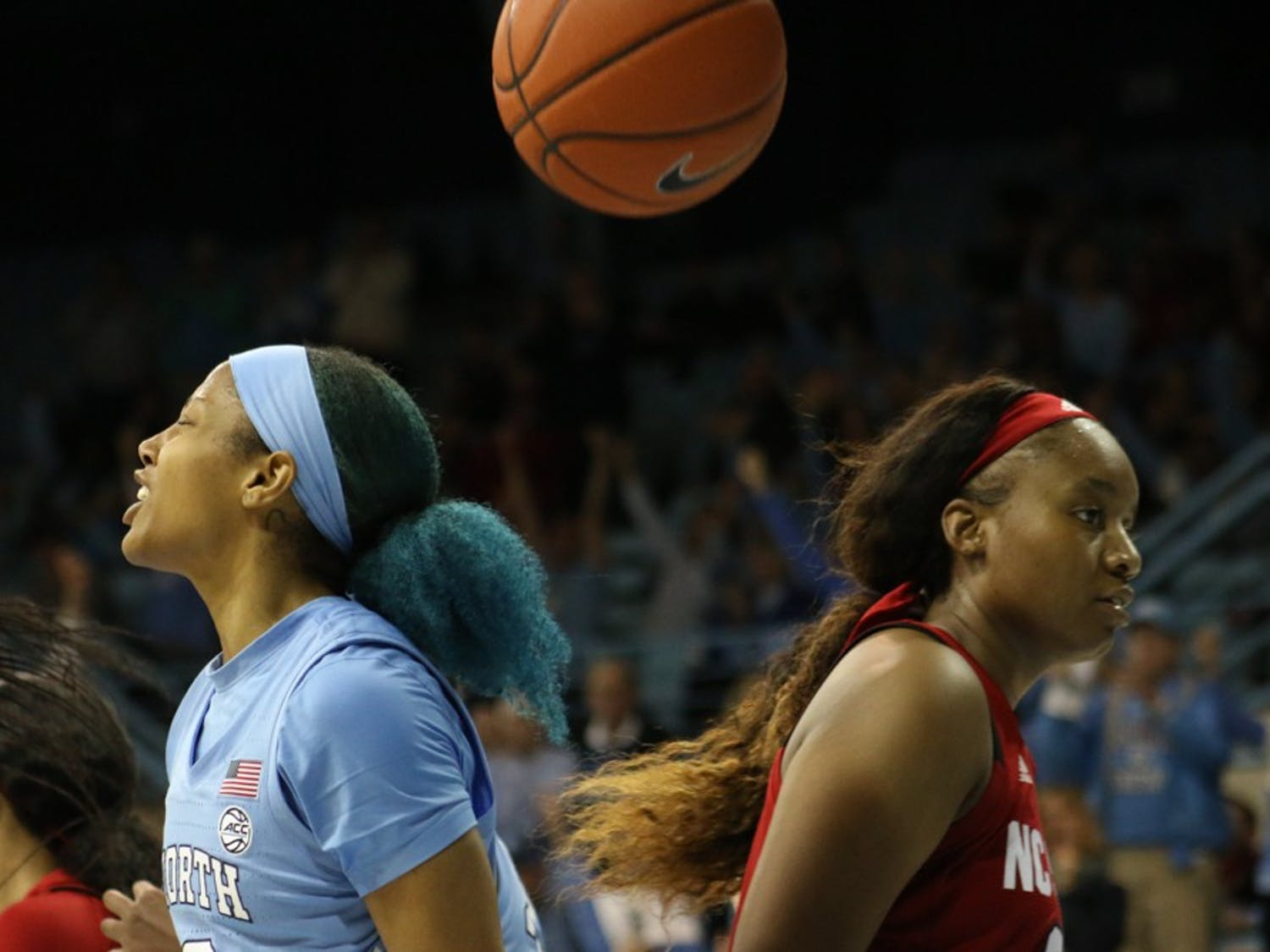UNC redshirt senior guard Madinah Muhammad (3) cheers after shooting a basket during a game against N.C. State on Thursday, Jan. 9, 2020 in Carmichael Arena. UNC won 66-60.