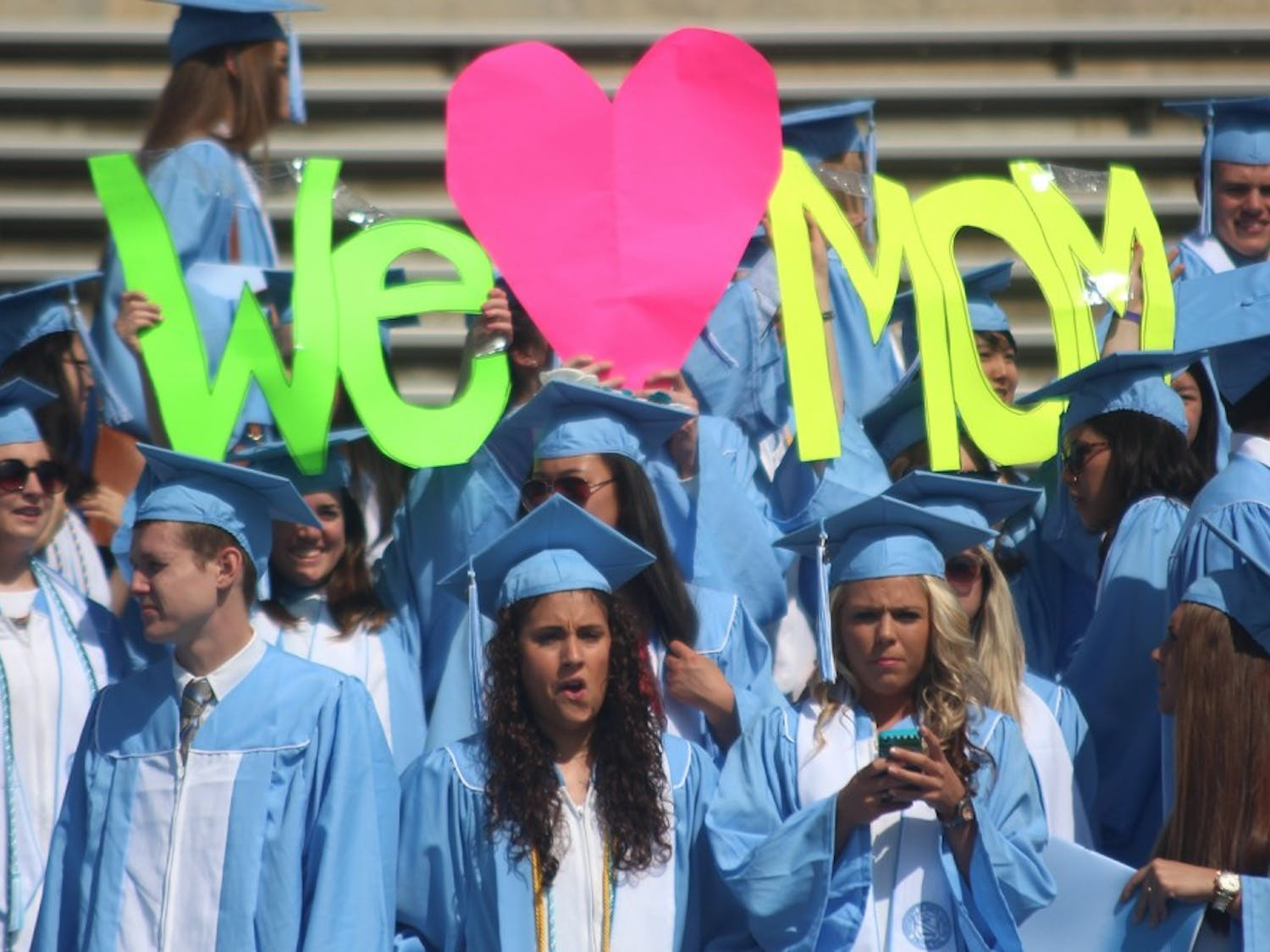 The Class of 2014 gathers for graduation on Mother's Day. Many students display a show of support for all the mothers attending.
