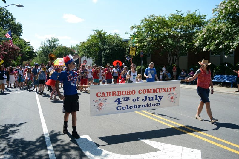 Carrboro residents gather near Weaver Street to begin the parade.