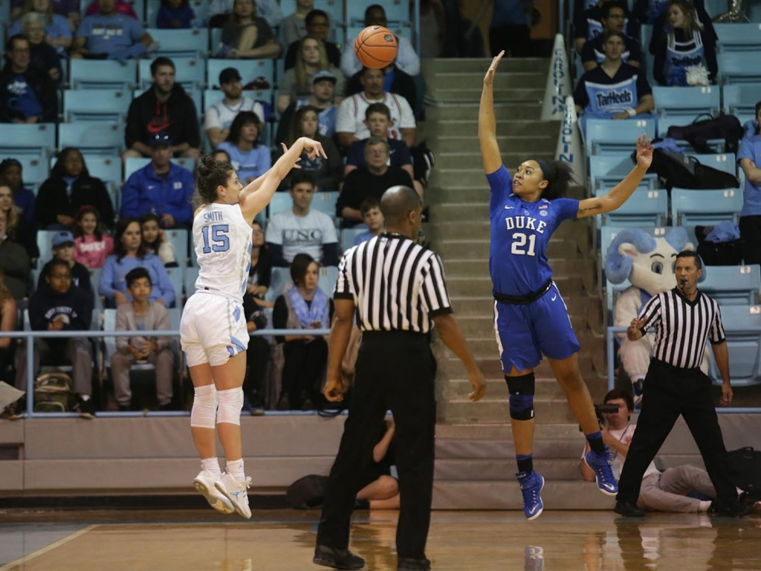 Olivia Smith (15)  shoots a three against Duke's Kendall Cooper (21) Sunday afternoon.