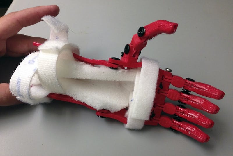 Jeff Powell, a senior biomedical engineering major and design chair of the UNC Biomedical Engineering Club, used a 3-D printer to make an affordable prosthetic hand for 7-year-old boy Holden Mora.Courtesy of Jeff Powell