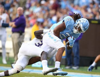 Running back Jordon Brown (2) tries to escape a Western Carolina defender on Saturday in Kenan Stadium.