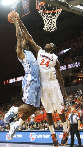 Justin Watts is stuffed by Virginia's KT Harrell, but the Tar Heels managed to rally for a 62-56 victory. Though Harrell led all scorers with 13 points, both teams shot below 27 percent in the second period.