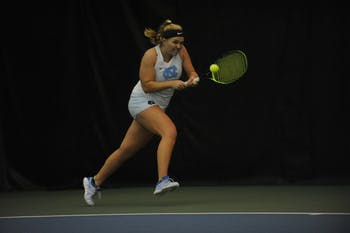 UNC women's tennis sophomore Alele Sanford prepares to return a ball during a singles match against Louisville on Sunday, March 3, 2019. UNC won the match against the Cardinals.