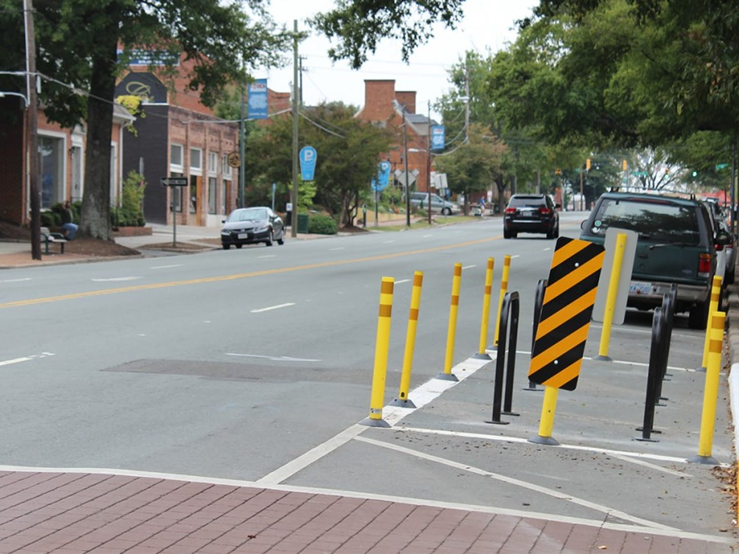 A biking corral has replaced a parking space on West Franklin Street.