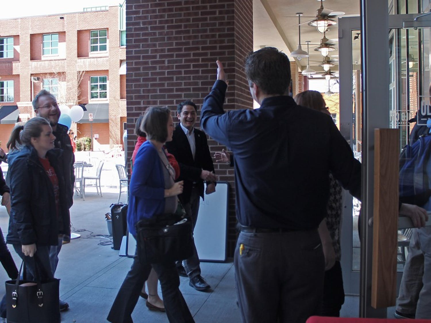Owner Jeremy Andrews opens his doors to customers on Thursday morning for the grand opening of Old Chicago.