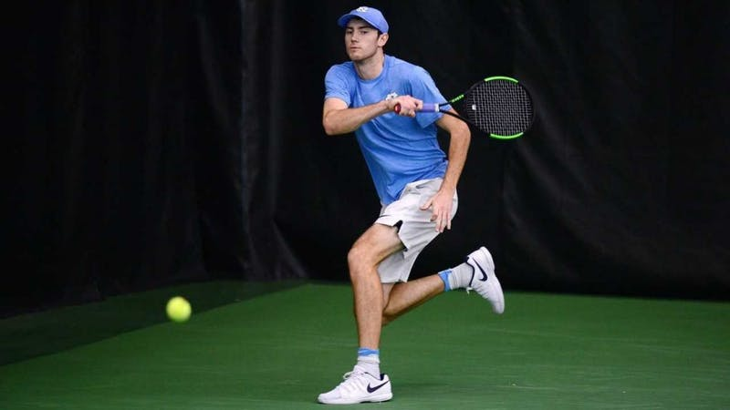 Sophomore Josh Peck prepares for a return against Illinois on Jan. 3 in the Cone-Kenfield Tennis Center. Photo courtesy of UNC Athletic Communications