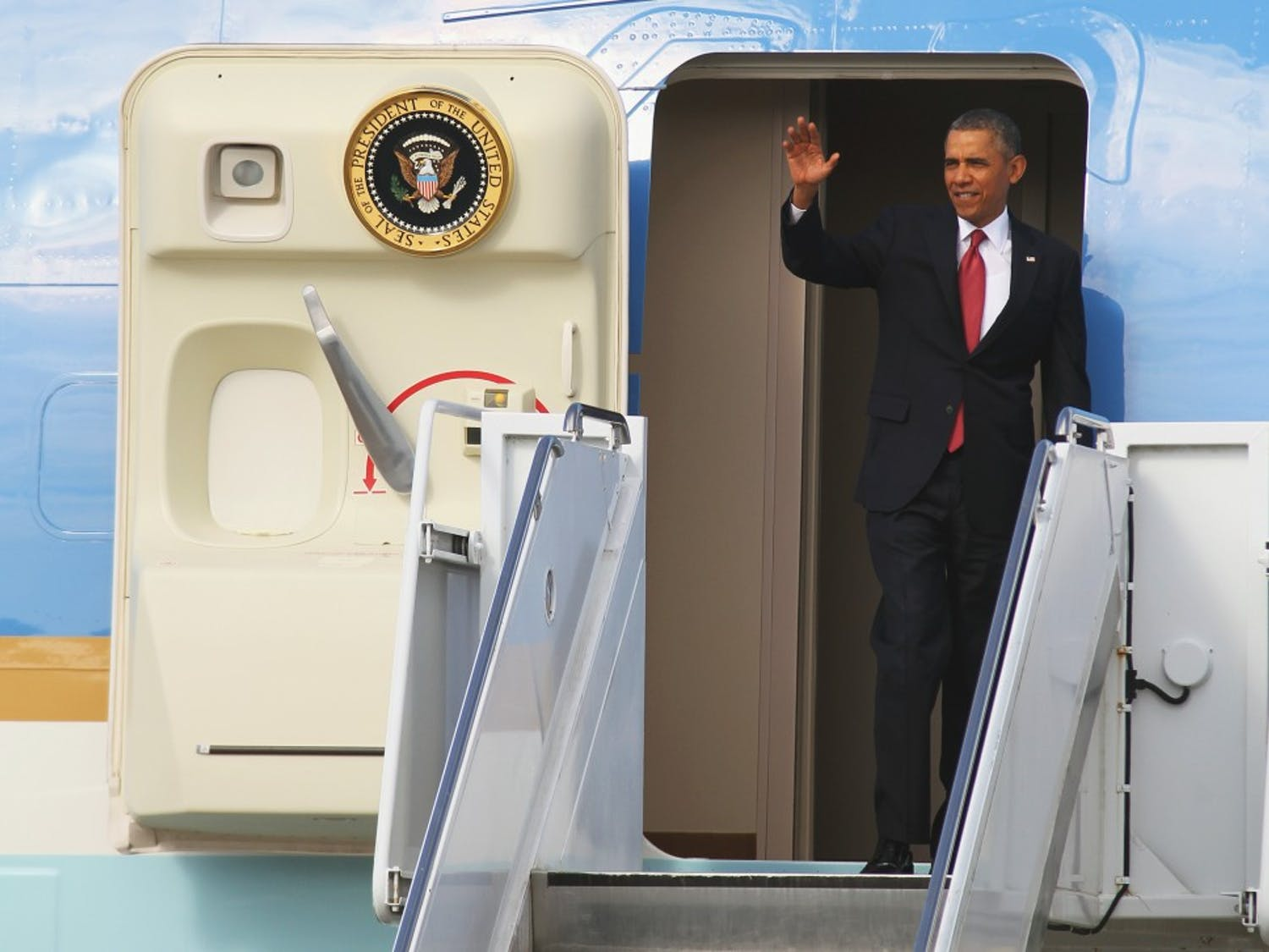 President Barack Obama exits Air Force One on Wednesday January 15.