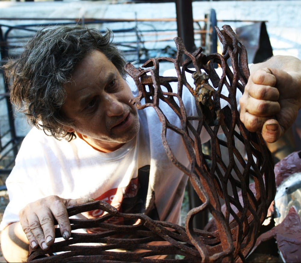 Chapel Hill recycled metal sculptor a 'performance artist at heart'