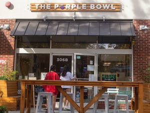 Customers walk into The Purple Bowl on Nov. 5 2020, one of the businesses that has been a victim to recent break-ins.