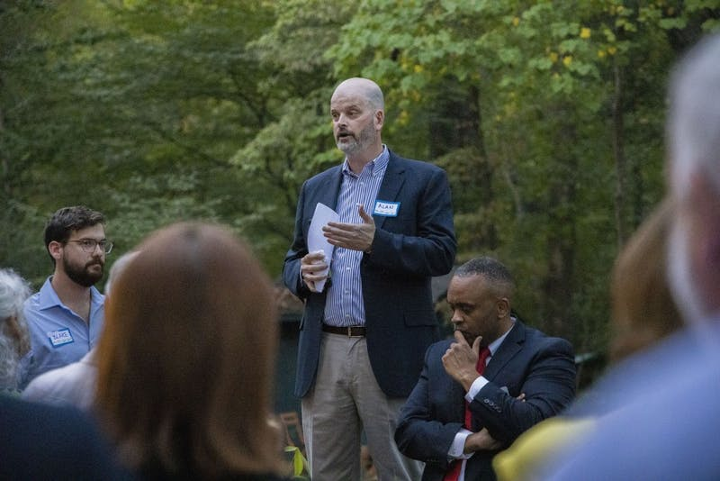 Alan Parry (center), Political Chair of the NC Sierra Club, delivers a welcoming speech at the organization's PAC Fundraiser on Thursday, Sept. 26, 2019 in Chapel Hill. Blake Fleming (left), lead organizer of the NC Sierra Club, and Rep. Robert Reives II (right), NC House member, also spoke at the event.