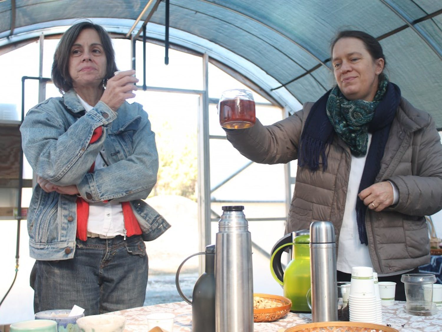 """(From left to right) Durham, NC resident Charley Rowe and local artisan Christine Parks sample tea that was sold at the """"Meet the Makers"""" event held at Camellia Forest Nursery on Saturday, Nov. 17, 2018."""