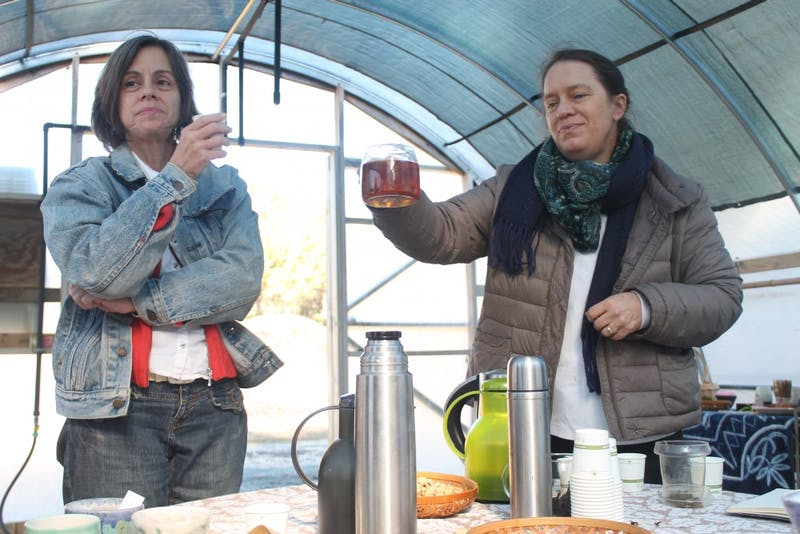"(From left to right) Durham, NC resident Charley Rowe and local artisan Christine Parks sample tea that was sold at the ""Meet the Makers"" event held at Camellia Forest Nursery on Saturday, Nov. 17, 2018."
