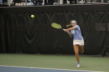 Sophomore Alle Sanford volleys back against her opponent from Virginia Commonwealth University on Jan. 26, 2019.