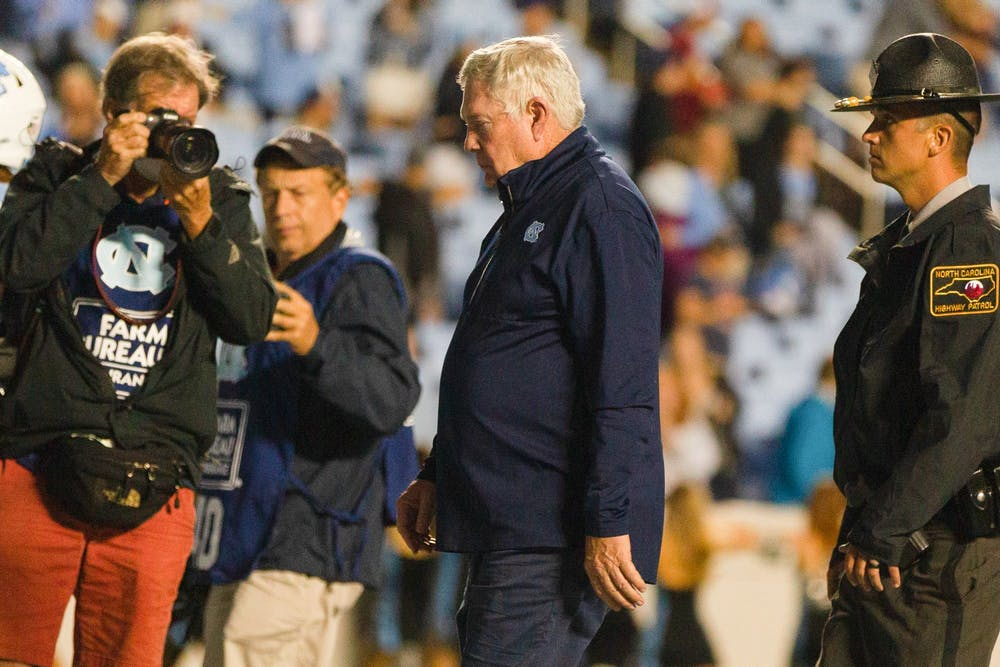 UNC head coach Mack Brown walks off the field after a devasting loss at the game against Florida State on Oct. 9 at Kenan Stadium. The Heels lost 35-25.