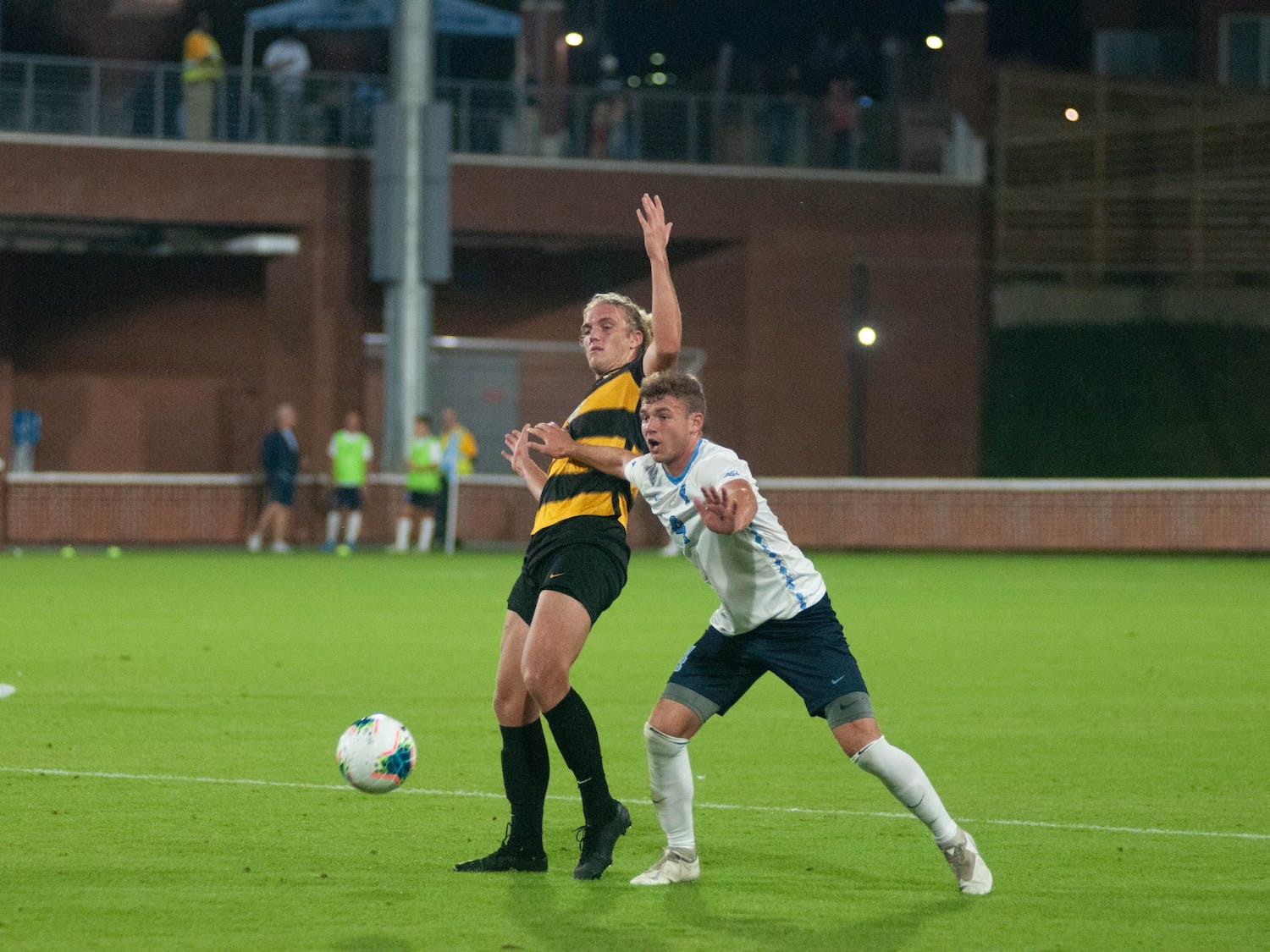 First-year UNC defender Blake Malone (4) and first-year Appalachian State University forward Nick Rodgers (8) fight for the ball on Tuesday, Oct. 29, 2019. UNC lost to Appalachian State University 1-0 on a penalty kick.
