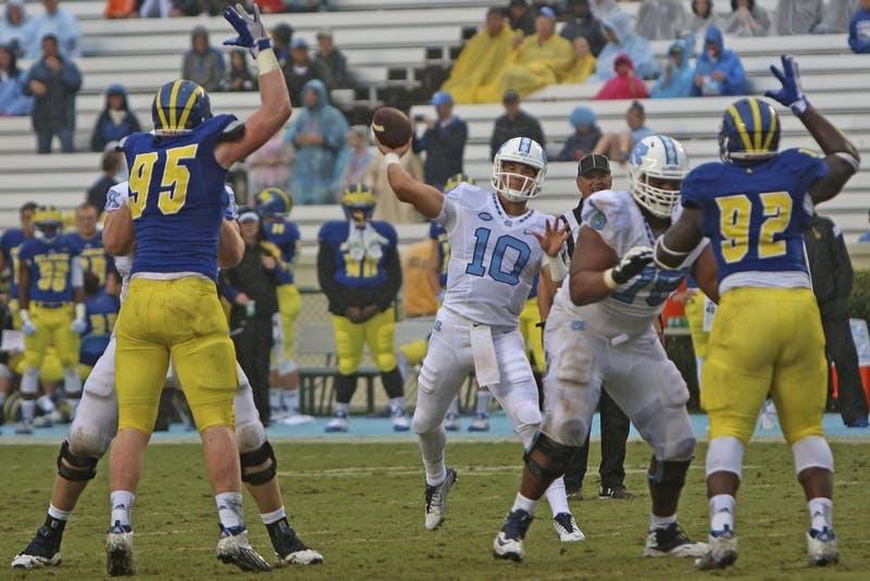 Mitch Trubisky (10) throws a pass during a gameagainst Delaware. Trubisky broke four personal records.