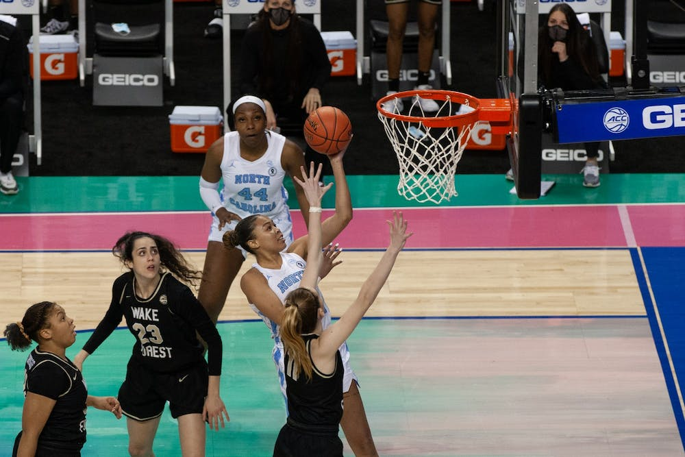 <p>UNC graduate guard Stephanie Watts attempts a layup in Carolina's 81-71 second-round ACC tournament loss to Wake Forest University at Greensboro Coliseum on Mar. 4, 2021.</p>