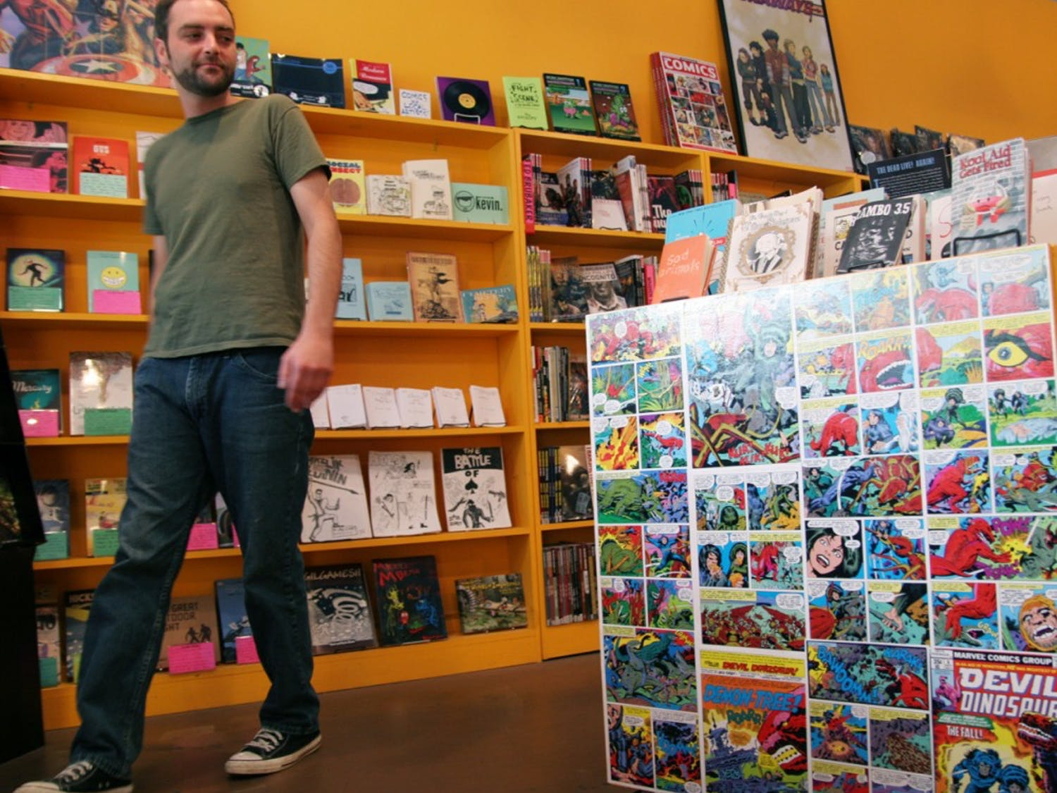 Mac Lomax peruses the local artist section of Chapel Hill Comics on West Franklin Street, which includes work by Yana Levy, 8, of Chapel Hill.