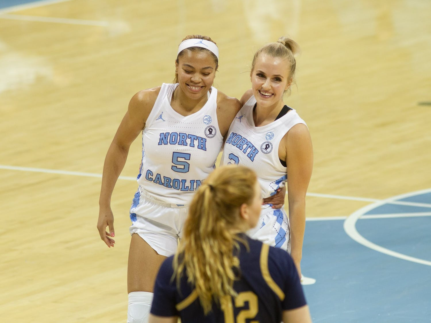 UNC guard Petra Holesinska (2) and guard Stephanie Watts (5) enjoying their win in Carmichael Arena on Jan. 24, 2021 after a game against Notre Dame. UNC defeated Notre Dame 78-73.