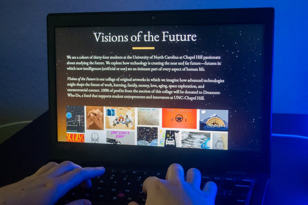 DTH Photo Illustration. Someone views Visions of the Future, a digital art project created by students in a UNC class during Spring 2021.