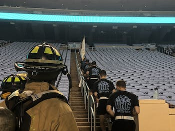 UNC army ROTC members and first responders climb stairs in Kenan Memorial Stadium to honor the lives lost in the 9/11 attacks.