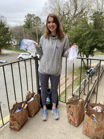 Maureen Whittelsey, director of Chapel Hill's Hearts for the Homeless' chapter, stands with soap kits the group produces. Photo courtesy of Kayla Ferro